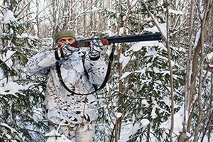 hunter with gun on winter hunting