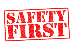 SAFETY FIRST red Rubber Stamp over a white background.